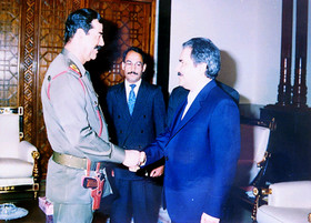 MEK Leader Masoud Rajavi and Saddam Hossein