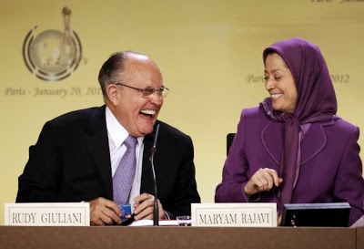 Rudy Giulani (L), former mayor of New-York city, shares a laugh with the president of the National Council of Resistance of Iran Maryam Rajavi (R) on January 20, 2012 in Paris, during an international conference regarding a solution for Camp Ashraf in Iraq, which is home to thousands of outlawed Iranian regime opponents. Camp Ashraf has become a mounting problem for the Iraqi authorities since US forces transferred security for the camp in January 2009, and amid pressure from Tehran to hand over the members of the militant group. The Iraqi government says the camp is a threat to its relations with neighboring Iran and is demanding that it close by December 31, 2011. But the United Nations appealed at the end of 2011 for an extension to the deadline to allow more time in negotiations with the camp's residents, who are refusing to move unless they are given UN protection.   JACQUES DEMARTHON / AFP PHOTO (Photo credit should read JACQUES DEMARTHON/AFP/Getty Images)